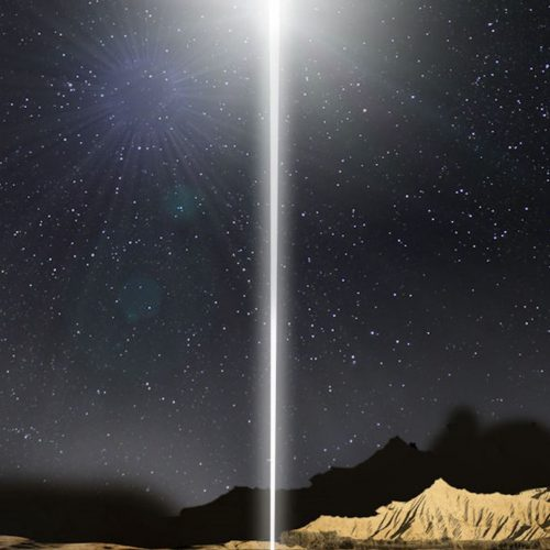 Christmas Eve- White light shining straight down from night sky with mountains in foreground