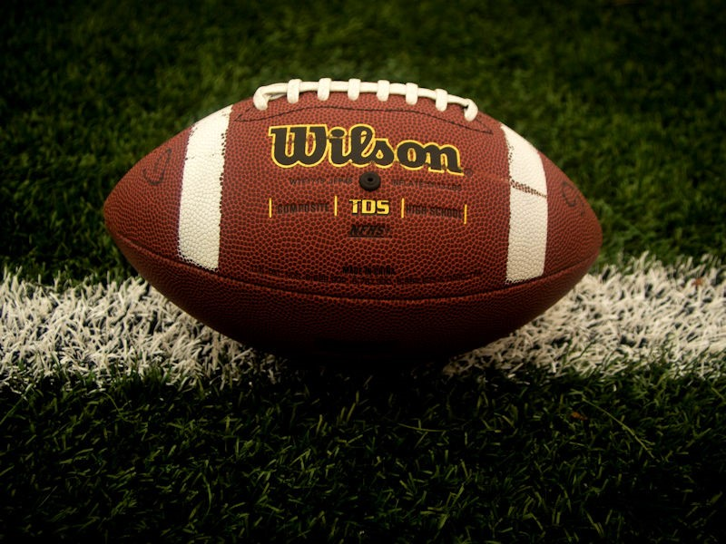 Spiritual Lessons Learned From Football- Brown and white leather football on grass