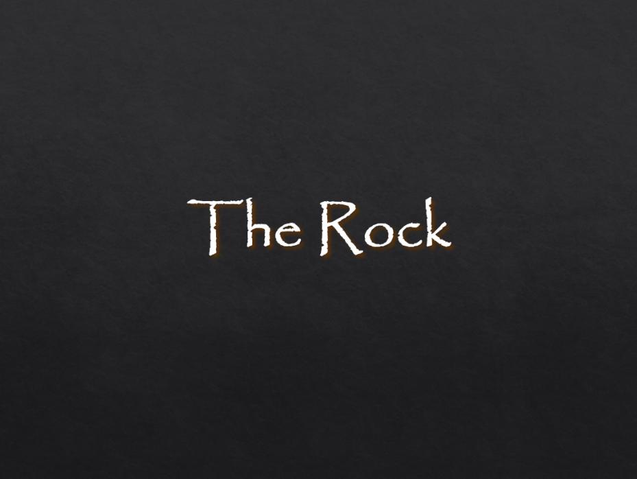 The Rock- Very dark grey, almost black background